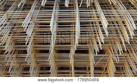 reinforcing mesh steel bars stacked for construction and background