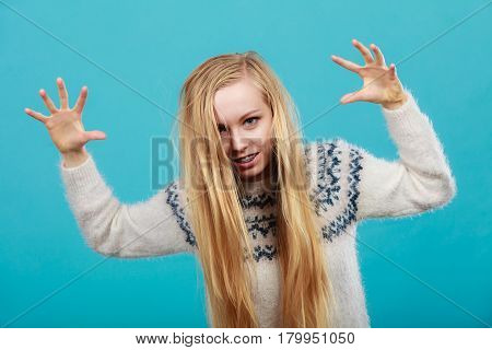 Young Blonde Woman Making Scary Faces
