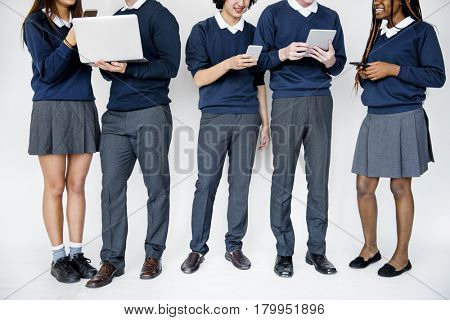Group of students using digital devices techie