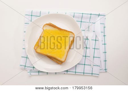 sweet toast butter meal on green pattern dish towel decoration on white background. this bread is thai style sweetmeat.