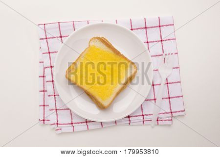 sweet toast butter meal with red pattern dish towel decoration on white background. this bread is thai style sweetmeat.