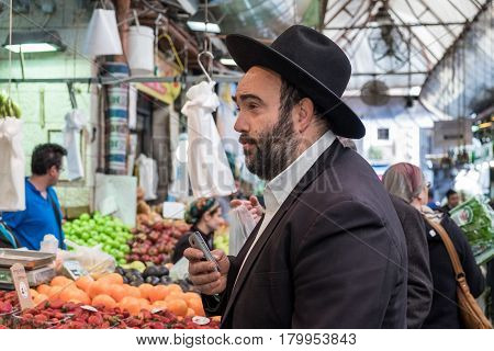 Undefined Orthodox Jewish Man With Mobile Phone, Purchase Meal At Mahane Yehuda Market, Popular Mark