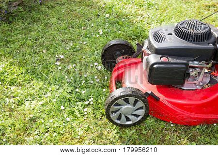 a red Lawnmower will cut the lawn