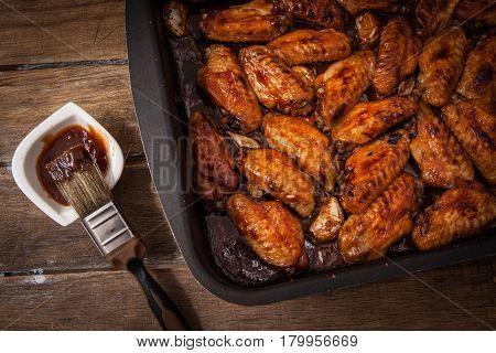 Preparing bbq sauce chicken wing on pot