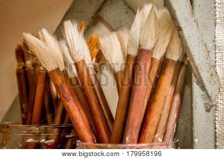 paint brushes in artist's studio