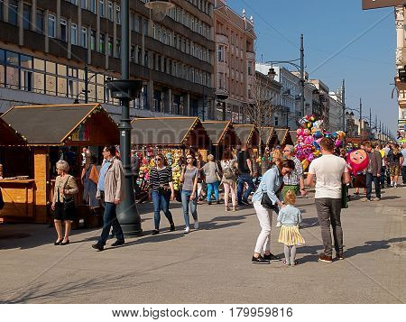Easter Fair in Lodz. Lodz, Poland - April 02, 2017 Residents of Lodz and tourists at the Easter Fair on Piotrkowska Street in Lodz.