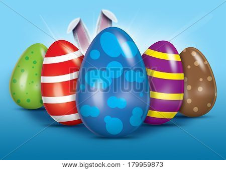 A collection of easter eggs with the easter bunnies ears poking out from behind them