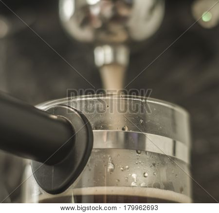 Espresso machine for strong coffee in shot glass pot on beautiful blur background closeup