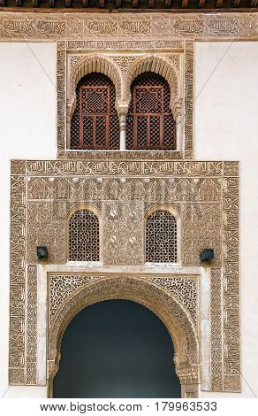 Arch with stone relief with arabesques in Alhambra palace Spain