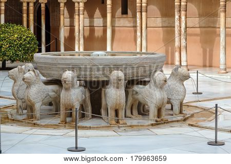 Fountain in court of the Lions is the main courtyard in Nasrid dynasty Palace Alhambra Granada Spain