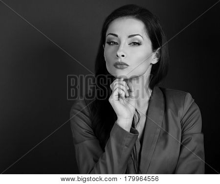 Beautiful Serious Business Woman In Grey Suit Thinking On Dark Background With Empty Copy Space. Bla