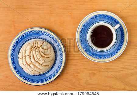 Mexican Concha Sweet Bread With Coffee Cup