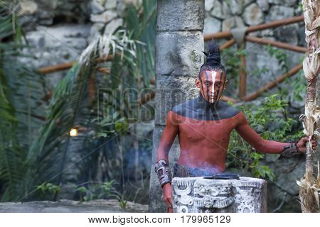 Tulum Mexico March 15th 2017: Man in Maya indian costume in Tulum Mexico