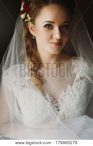 gorgeous bride elegant portrait in the morning soft light. sensual look of woman in wedding getting ready ceremony gentle atmospheric moment
