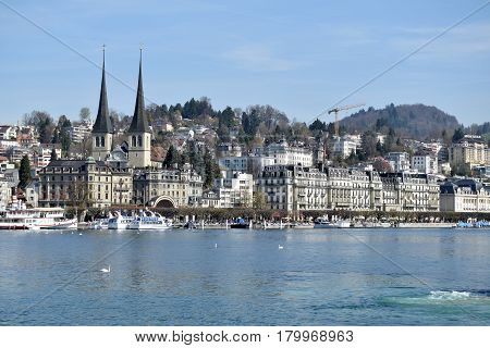 30 March 2017-Lucerne-Switzerland-Panoramic view of the city of Lucerne and its lake a destination for tourists flocking to its shores and its boats. At the center the cathedral and its towers.