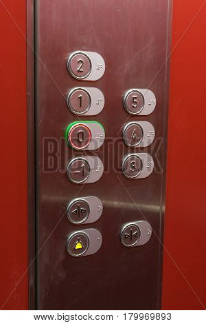Metal lift control on a red background
