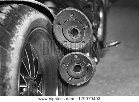 Exhaust pipes of a motorcycle selective focus in black and white
