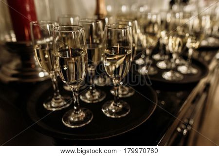 Luxury Crystal Champagne And Wine Glasses On Dark Wooden Background - Wedding Reception Table Arrang