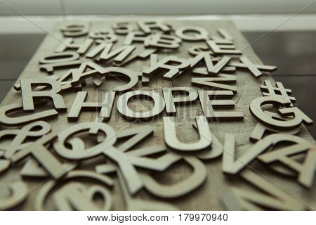 The word HOPE spelled in wooden letters