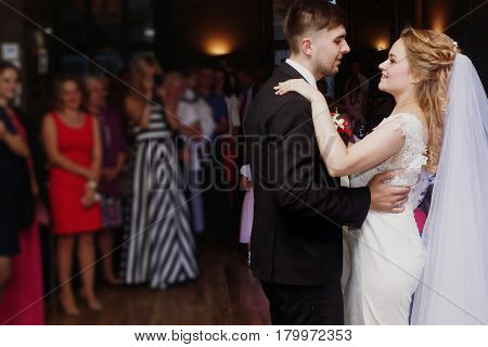 Romantic Bride And Groom Dancing And Holding Hands At Wedding Reception In Restaurante, Newlywed Cou