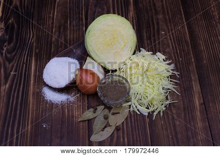 Food fermentation preparation for making sauerkraut: White cabbage salt onion black pepper bay leaf cloves. Healthy food
