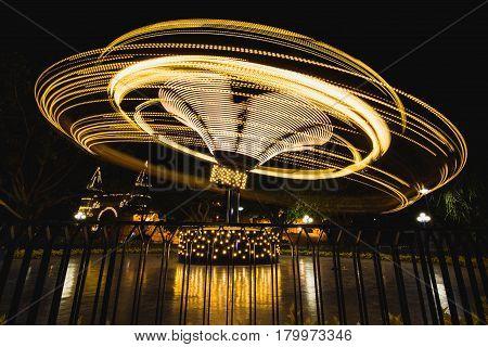 Night shots of lighted amusement rides, Vietnam