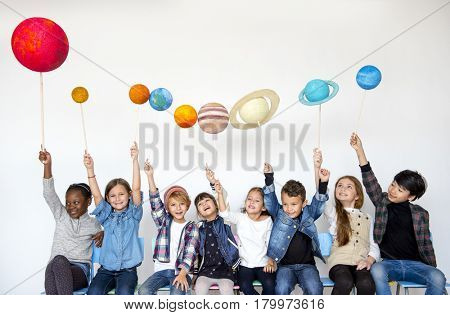 Happiness group of cute and adorable children with solar system in universe