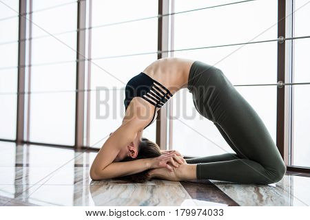 Setu Bandha Sirsasana. Beautiful Yoga Woman Practice Near Window Yoga Room Studio Background. Yoga C