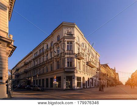 Architecture in Piotrkowska Street in Lodz Poland evening foto. Main shopping street.