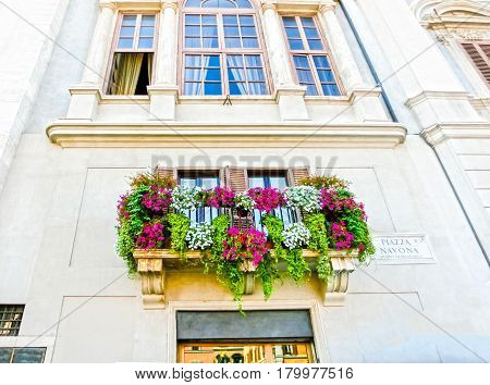 Rome, Italy - September 10, 2015: The facade of historical house at Piazza Navona on September 10, 2015 in Rome, Italy. Piazza Navona is a popular destination in Rome, the 3rd most visited city in European Union.