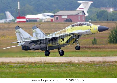 ZHUKOVSKY, MOSCOW REGION, RUSSIA - JULY 18, 2014: Mikoyan MiG-29K 30 BLACK jet fighter of russian NAvy performing test flight in Zhukovsky, Moscow region, Russia