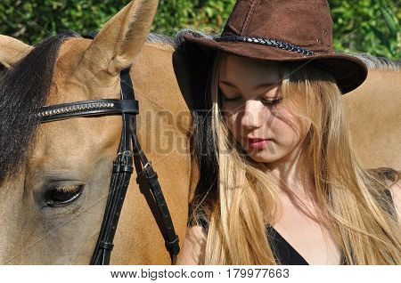 portrait of teenage girl and horse in summer day