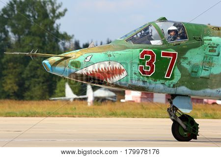 KUBINKA, MOSCOW REGION, RUSSIA - AUGUST 7, 2014: Su-25 37 RED taxiing at Kubinka air force base.