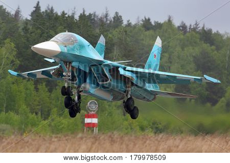 KUBINKA, MOSCOW REGION, RUSSIA - MAY 18, 2015: Sukhoi Su-34 bomber landing at Kubinka air force base, Moscow region, Russia.