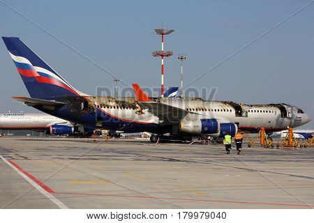 SHEREMETYEVO, MOSCOW REGION, RUSSIA - JUNE 3, 2014: Ilyushin IL-96-300 caught fire while standing at Sheremetyevo international airport.