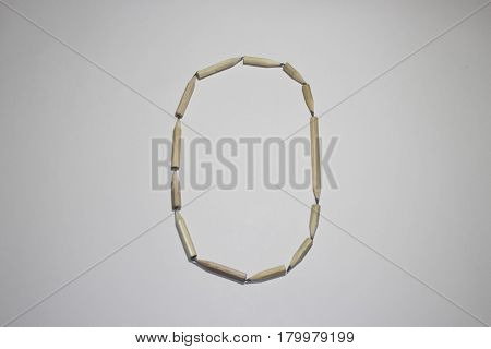 Alphabet symbol - letter O pencil on white background