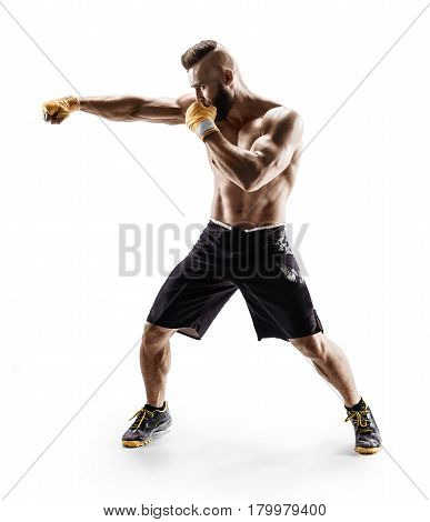 Muscular male in sports clothes сonducts fight with shadow. Photo of boxer on white background. Strength and motivation