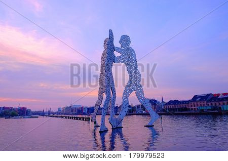 View on the Molecule Man sculpture on sunrise on the river Sprea. Berlin Germany - 01.04.2017.