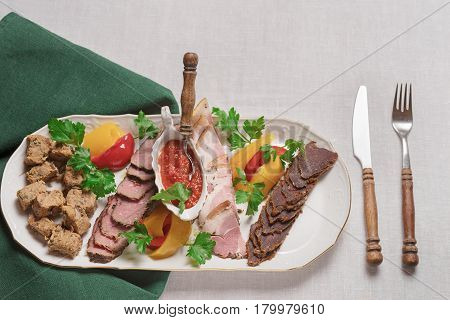 Plate Of Meat Delicacies Of Wild Boar, Wild Duck, Elk, Hare Top View, Close-up
