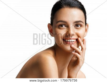 Smiling happy girl sitting over white background. Photo of pretty girl with slim toned body. Beauty & Skin care concept