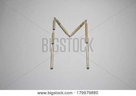 Alphabet symbol - letter M pencil on white background