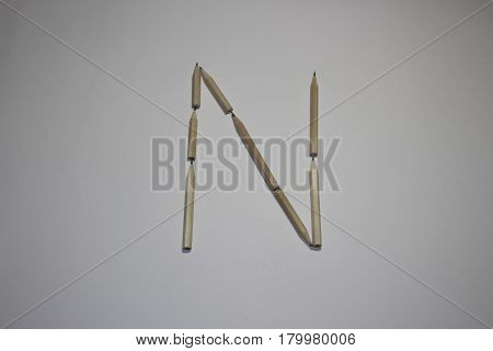 Alphabet symbol - letter N pencil on white background