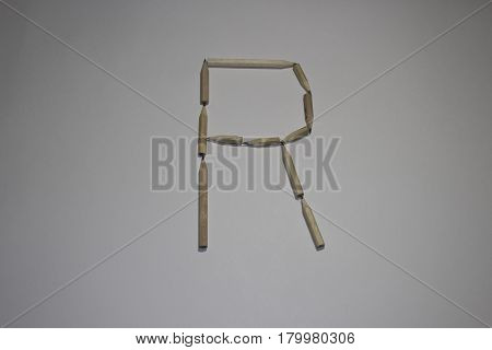Alphabet symbol - letter R pencil on white background