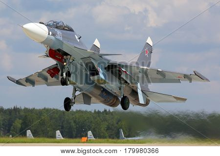 KUBINKA, MOSCOW REGION, RUSSIA - JUNE 22, 2015: Naval SU-30SM jet fighter takes off at Kubinka air force base, Moscow region, Russia.