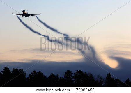 Mcdonnell Douglas MD-11F civil cargo airplane landing with vortexes coming from wingtips.