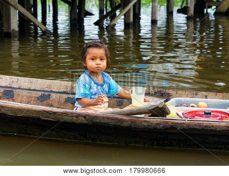 IQUITOS PERU - MARCH 17: Young girl in a canoe in Iquitos Peru on March 17 2015