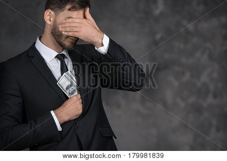 Male person putting money banknotes into pocket finance corruption