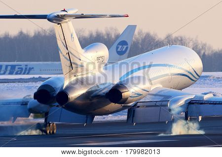 VNUKOVO, MOSCOW REGION, RUSSIA - MARCH 23, 2013: Gazpromavia Tupolev Tu-154M touchdown at Vnukovo international airport.