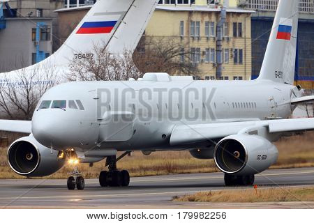 ZHUKOVSKY, MOSCOW REGION, RUSSIA - OCTOBER 19, 2013: Tupolev Tu-204R reconnaissance aircraft taxiing at Zhukovsky.