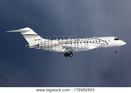 VNUKOVO, MOSCOW REGION, RUSSIA - MARCH 16, 2012: Private Bombardier Global Express BD-700 OH-TNF landing at Vnukovo international airport.